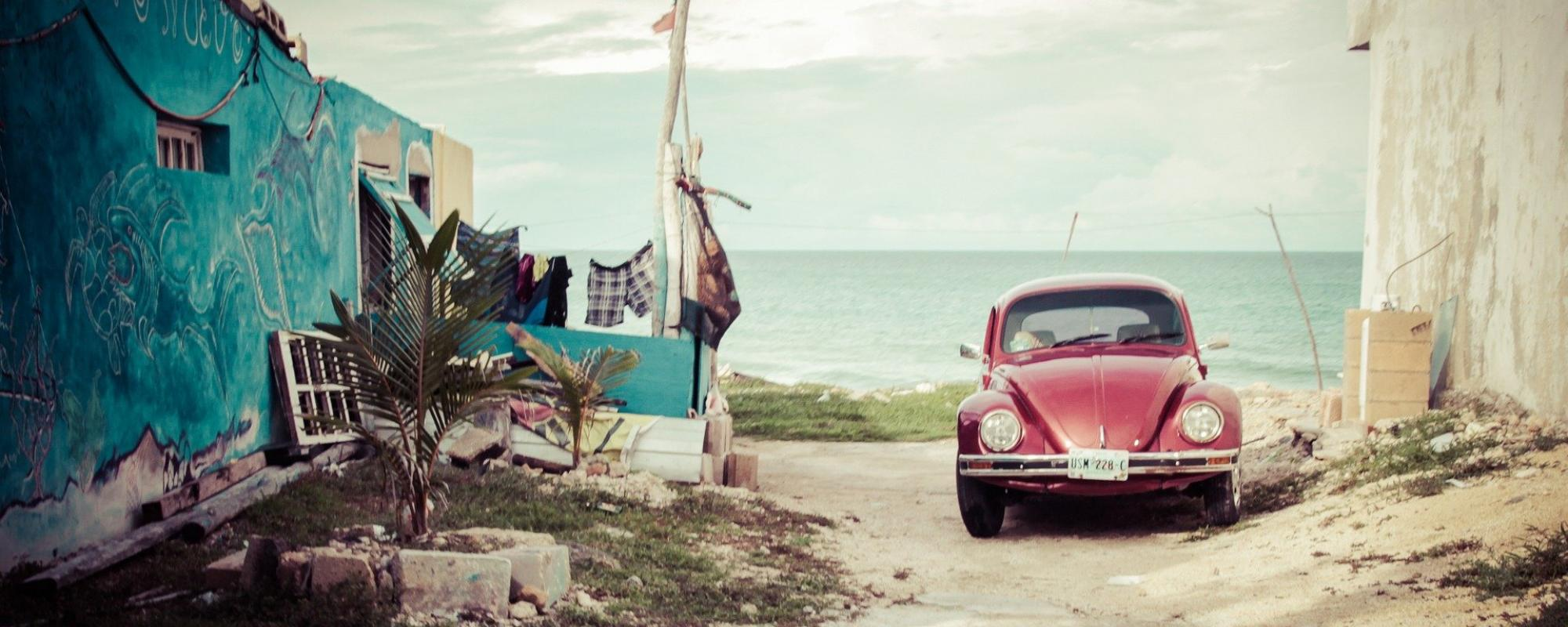 Old car and house on the border