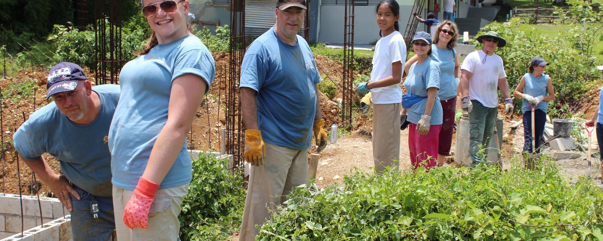 volunteers working in a garden or field